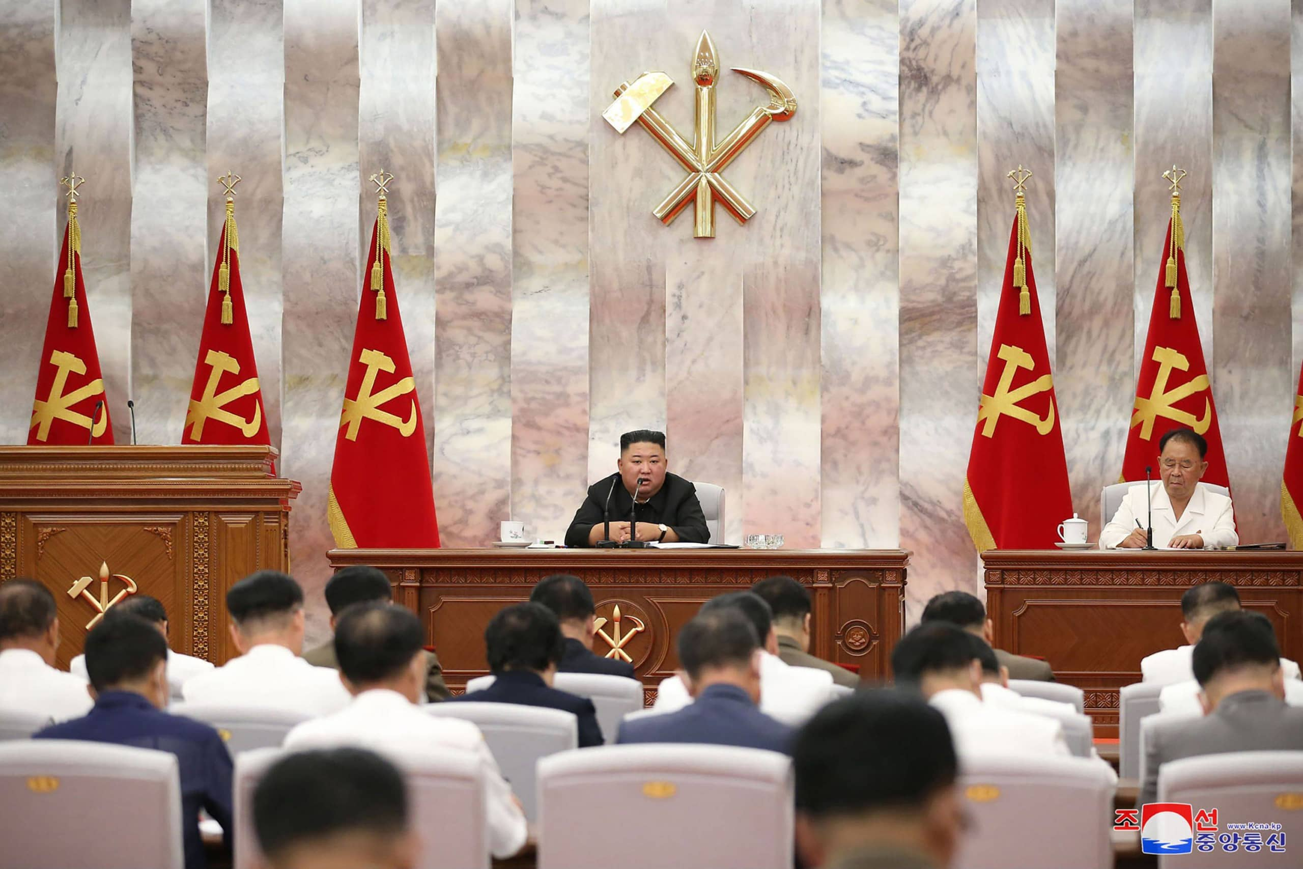 North Korean leader Kim Jong Un attends a conference in Pyongyang on Tuesday on damage inflicted by Typhoon Maysak. | AFP-JIJI