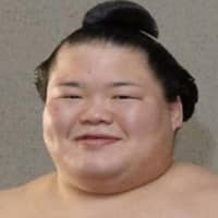 Fujiazuma and other sumo wrestlers from the Tamanoi stable have tested positive for COVID-19. | KYODO