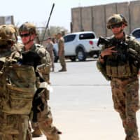 U.S. soldiers are seen during a handover ceremony of Taji military base north of Baghdad to Iraqi security forces on Aug. 23, 2020.   | REUTERS