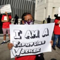 Laid-off airport workers hold a protest to call for the need to extend health care benefits amid the global outbreak of the coronavirus disease at the Tom Bradley International terminal of LAX Airport in Los Angeles on Sept 3.   | REUTERS