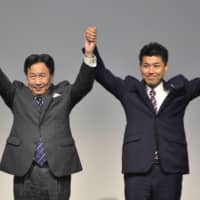 Yukio Edano (left) received 107 of the votes cast by the 149 Diet members who comprise the new Constitutional Democratic Party of Japan. Challenger Kenta Izumi, 46, who had been the policy chief of the Democratic Party for the People, secured 42 votes. | POOL / VIA AP
