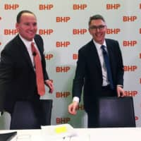 BHP Chairman Ken MacKenzie and incoming CEO Mike Henry hold a news conference to announce Henry's appointment to the job at the firm's Melbourne headquarters in November 2019. | REUTERS