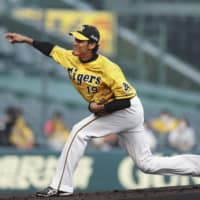 Tigers pitcher Shintaro Fujinami was one of the first NPB players to test positive for the coronavirus in late March. | KYODO