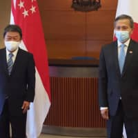 Foreign Minister Toshimitsu Motegi (left) and his Singaporean counterpart Vivian Balakrishnan pose for a photo in Singapore on Aug. 13. | FOREIGN MINISTRY / VIA KYODO