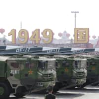 Military vehicles carrying hypersonic DF-17 missiles travel past Beijing's Tiananmen Square during a military parade marking the 70th founding anniversary of People's Republic of China on Oct. 1. | REUTERS