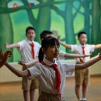 Students attend a dance class at an elementary school in Wuhan on Sept. 4.  | AFP-JIJI