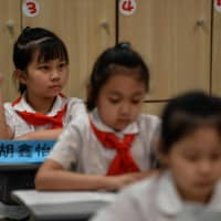 As countries around the world struggle to safely reopen schools this fall, China is harnessing the power of its authoritarian system to offer in-person learning for about 195 million students in kindergarten through 12th grade at public schools. | AFP-JIJI