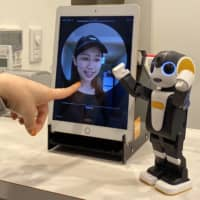 Sharp Corp.'s mobile robot, RoBoHon, began manning a hotel reception desk in Tokyo's Toranomon neighborhood in June. | COURTESY OF SHARP CORP.