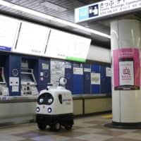 ZMP Inc.'s PATORO, an unmanned, self-driving security robot, patrols and disinfects a ticket vending area at Tokyo's Tsukishima Station.  | COURTESY OF ZMP INC.
