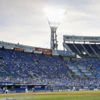 Fans watch a game between the BayStars and Dragons on Friday at Yokohama Stadium. | KYODO