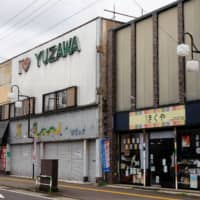 Many stores are shuttered in Yuzawa, Akita Prefecture, the hometown of Chief Cabinet Secretary Yoshihide Suga. | REUTERS