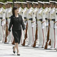 Former Defense Minister Tomomi Inada reviews a guard of honor after attending a ceremony marking the end of her duties at the Defense Ministry in Tokyo on July 31, 2017, following her resignation over a data cover-up scandal.   KYODO