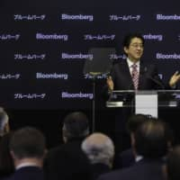 Prime Minister Shinzo Abe pledged to push for further improvements in corporate governance in New York in September 2015. | BLOOMBERG