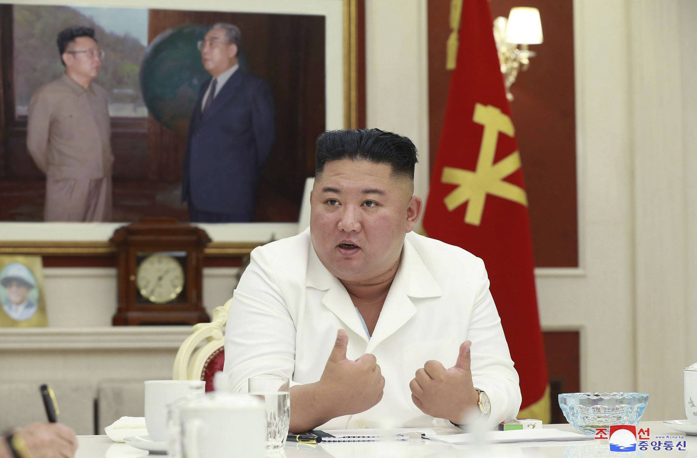 North Korea's economic plight may give Japan's next prime minister a chance to meet the reclusive state's leader Kim Jong Un. | KNS / VIA KYODO