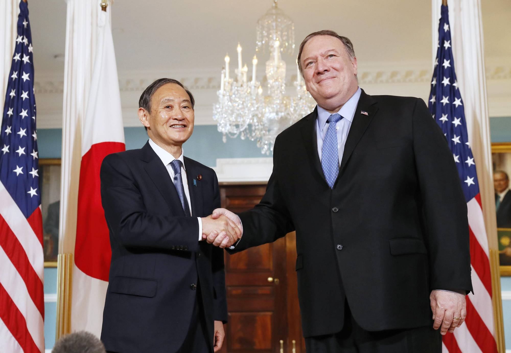 Chief Cabinet Secretary Yoshihide Suga and U.S. Secretary of State Mike Pompeo held talks in May 2019 in Washington. | KYODO