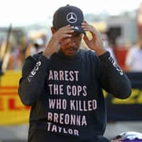 Mercedes driver Lewis Hamilton of Britain wears a T-shirt referencing Breonna Taylor after winning the Formula One Grand Prix of Tuscany on Sunday in Scarperia, Italy. | POOL / VIA AP