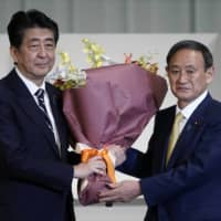 Abe's last national security legacy for Suga to complete