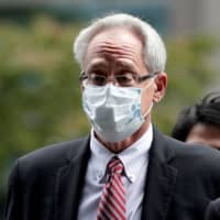 Former Nissan Co. director Greg Kelly pleaded not guilty Tuesday to conspiring to understate the remuneration of his former boss Carlos Ghosn by billions of yen, during the first hearing of his trial at the Tokyo District Court. | POOL / VIA REUTERS