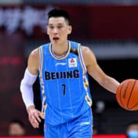 Jeremy Lin has announced his intention to leave the Chinese Basketball Association's Beijing Ducks and attempt an NBA comeback. | AFP-JIJI