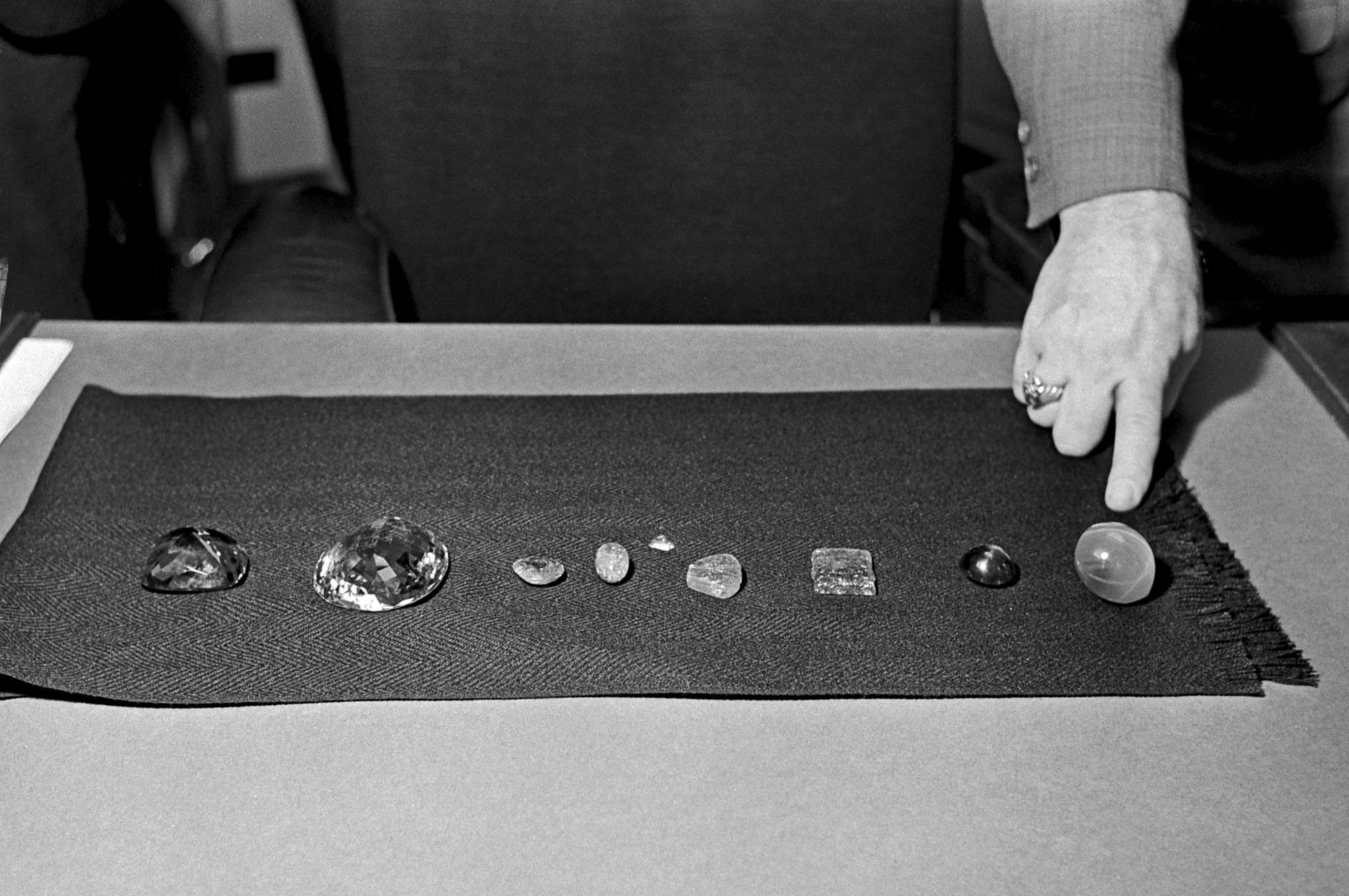 Recovered jewels that were stolen from the Museum of Natural History, included the Star of India sapphire, far right, at the office District Attorney Frank Hogan in New York.   ERNIE SISTO / THE NEW YORK TIMES