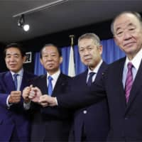The LDP's newly selected executives speak to the press on Tuesday. |  KYODO
