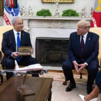 U.S. President Donald Trump and Israeli Prime Minister Benjamin Netanyahu meet in the Oval Office of the White House on Tuesday.  | DOUG MILLS / THE NEW YORK TIMES