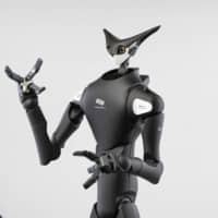 Japan's robots fill the void as social distancing becomes the norm