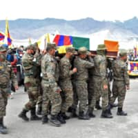 Indian soldiers carry a coffin containing the body of Tenzin Nyima on Sept. 7.  | REUTERS