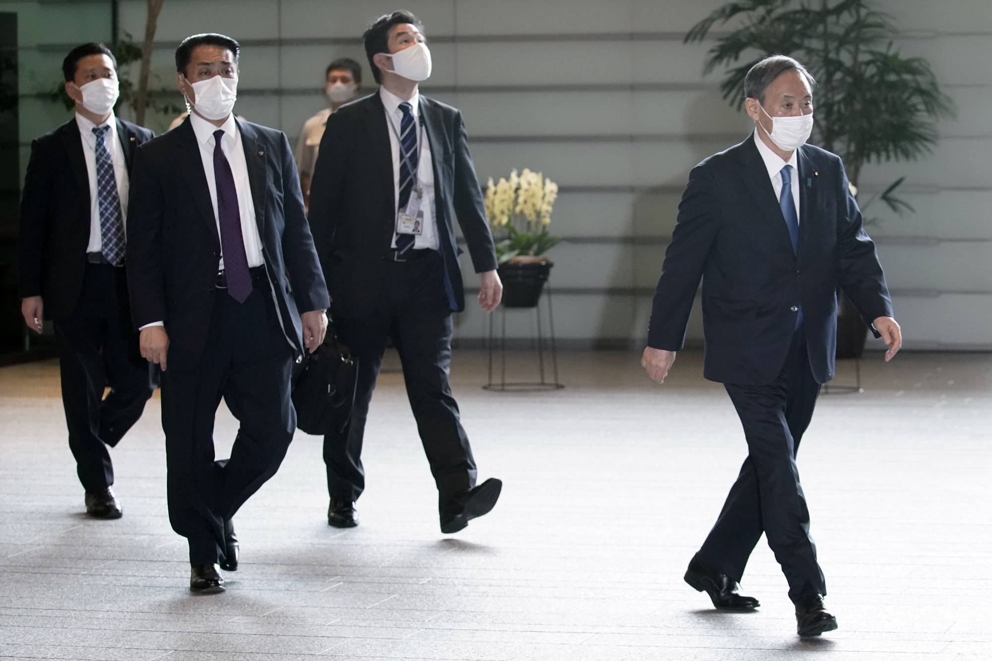 Yoshihide Suga, the nation's new prime minister, leaves the Prime Minister's Office on Wednesday. | AP