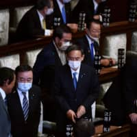 Yoshihide Suga attends a Lower House session to vote for the next prime minister in Tokyo on Wednesday. | AFP-JIJI