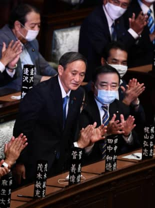 Yoshihide Suga reacts after he was elected prime minister by the Lower House on Wednesday. | AFP-JIJI