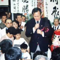 Yoshihide Suga speaks after winning a seat in the Yokohama Municipal Assembly for the first time in 1987.