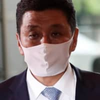 Newly-appointed Defense Minister Nobuo Kishi arrives at Prime Minister's Office on Wednesday. | REUTERS