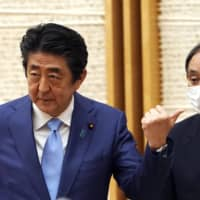 Experts say outgoing Prime Minister Shinzo Abe is highly likely to be involved at least in some way with the new administration. | POOL / VIA AP