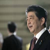 Experts say outgoing Prime Minister Shinzo Abe is highly likely to be involved at least in some way with the new administration. | AP