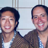 Early days: Hitoshi Ohashi and Bob Tobin pose for a picture in matching outfits in 1993. | COURTESY OF BOB TOBIN