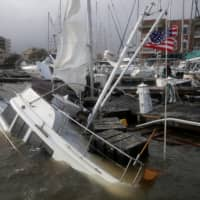 An U.S. flag flies from a boat damaged by Hurricane Sally in Pensacola, Florida, on Wednesday.  | REUTERS