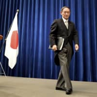 Prime Minister Yoshihide Suga leaves his first news conference as prime minister Wednesday night. | POOL / VIA KYODO