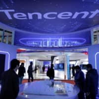People visit Tencent's booth at the World 5G Exhibition in Beijing in November 2019.  | REUTERS
