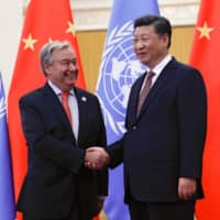 United Nations Secretary-General Antonio Guterres greets Chinese President Xi Jinping before a meeting at the Great Hall of the People in Beijing in 2018. | REUTERS