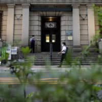 The Bank of Japan kept its aggressive monetary stimulus unchanged at a policy board meeting Thursday. | BLOOMBERG