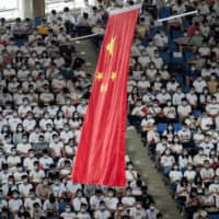 Chinese students at home and abroad have become the object of scrutiny over theft of intellectual property and harassment of academics. | STR / AFP-JIJI