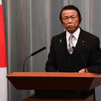 Finance Minister Taro Aso retained his post, a sign of continuity from the previous administration under former Prime Minister Shinzo Abe. | AFP-JIJI