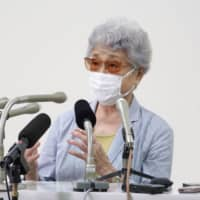 Sakie Yokota, whose daughter Megumi was abducted by North Korea in 1977 at age 13, speaks to the media in Kawasaki on Wednesday after Yoshihide Suga became prime minister the same day. | KYODO