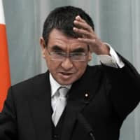Taro Kono speaks at a news conference at the Prime Minister's Office in the early hours of Thursday upon his appointment as administrative reform minister.   AP