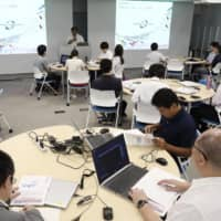 Security systems administrators of the Tokyo Games participate in cybersecurity drills in Tokyo in August 2019. | KYODO