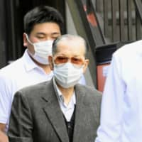 Former Japan Life Co. Chairman Takayoshi Yamaguchi is seen in Tokyo's Bunkyo Ward Friday after being arrested on suspicion of fraud. | KYODO