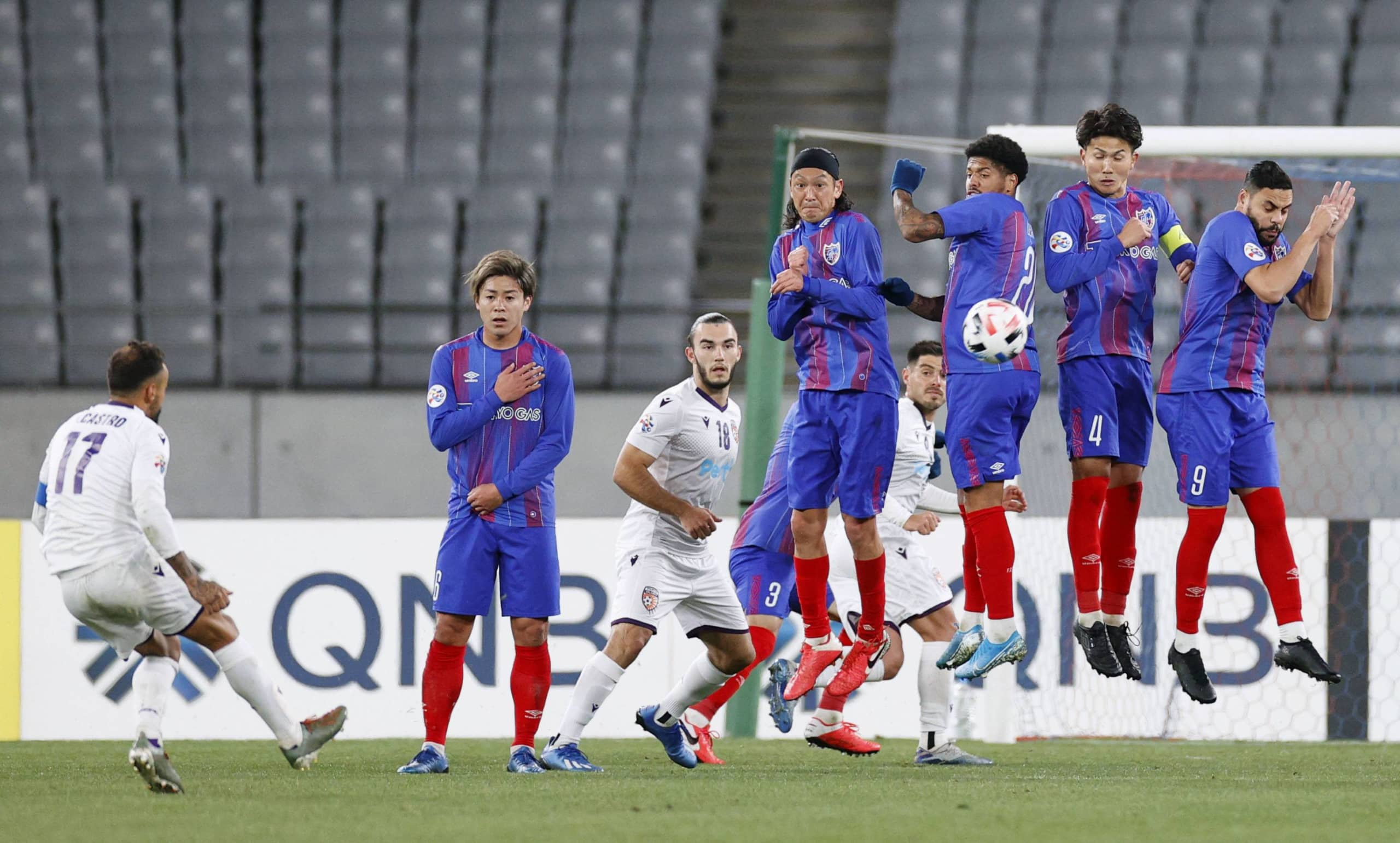 Tokyo players block a free kick during their ACL group stage game against Perth on Feb. 18 at Tokyo Stadium. | KYODO