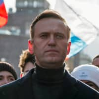 Russian opposition politician Alexei Navalny takes part in a rally in February.  | REUTERS