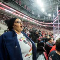 Renee Hess, founder of Black Girl Hockey Club, attends a pre-pandemic Carolina Hurricanes game at PNC Arena in Raleigh, N.C., in February 2020. What started as a group to help Black women feel more comfortable attending games has gotten the ear of executives who want to make the sport more inclusive. | KATE MEDLEY / THE NEW YORK TIMES